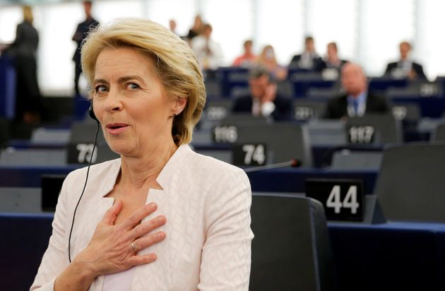 Elected European Commission President Ursula von der Leyen reacts after a vote on her election at the...