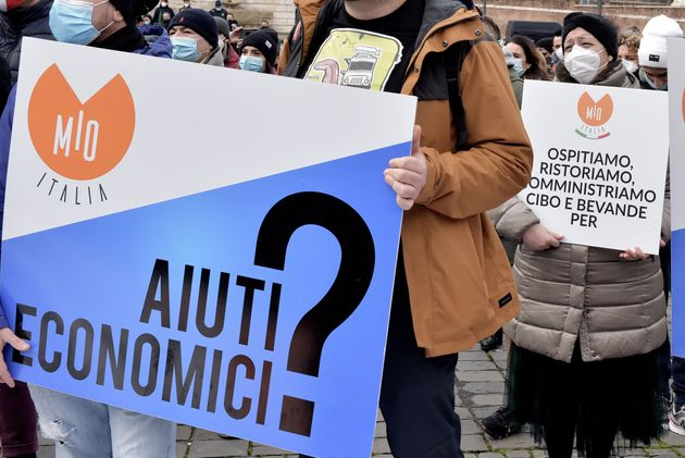 ROME, ITALY - JANUARY 25: Hospitality workers protest over Covid-19 measures at Piazza del Popolo, demanding...