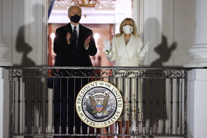 U.S. President Joe Biden and first lady Jill Biden watch a fireworks show on the National Mall from the Truman Balcony at the White House January 20, 2021 in Washington, DC.
