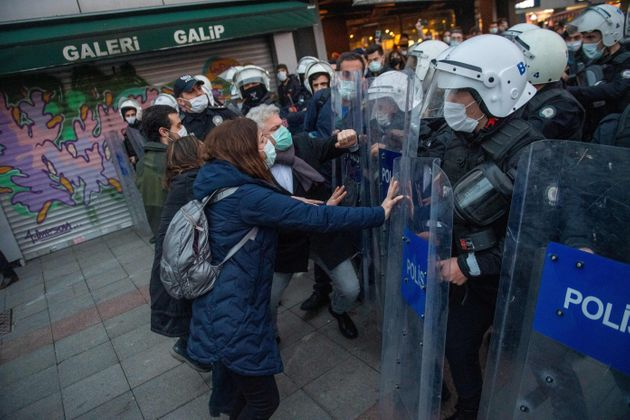 Turkish police face protestors on February 2, 2021 during a demonstration against Turkish President's...