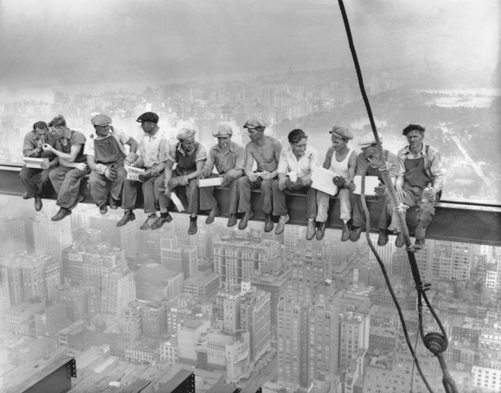 This famous photograph from 1932 depicts steelworkers eating lunch atop the 70-story RCA building while New York's thousands rush to crowded restaurants and congested lunch counters for their noon lunch below.