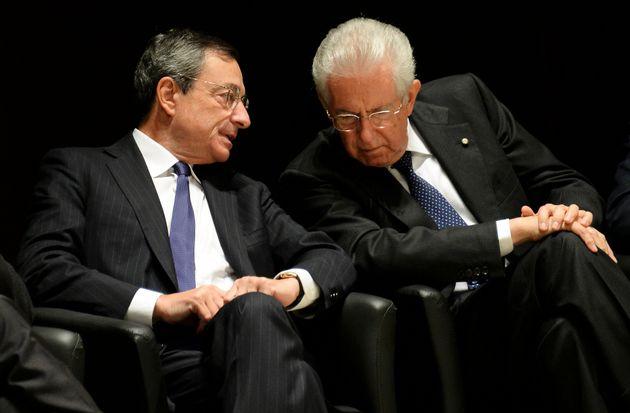 European Central Bank Governor Mario Draghi (L) talks with former Italian prime minister Mario Monti...