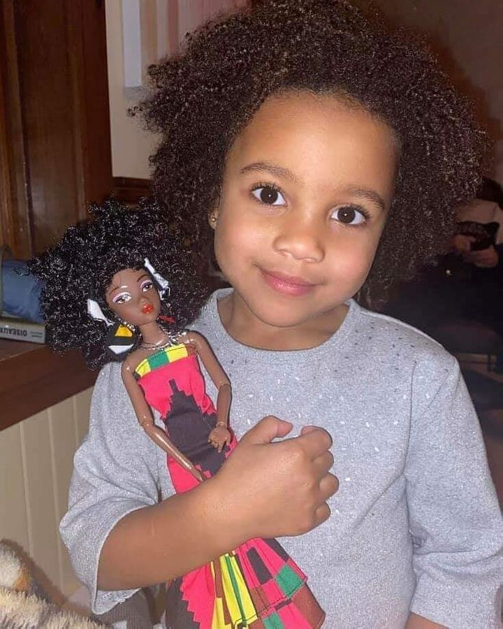A little girl with her Ymma doll.