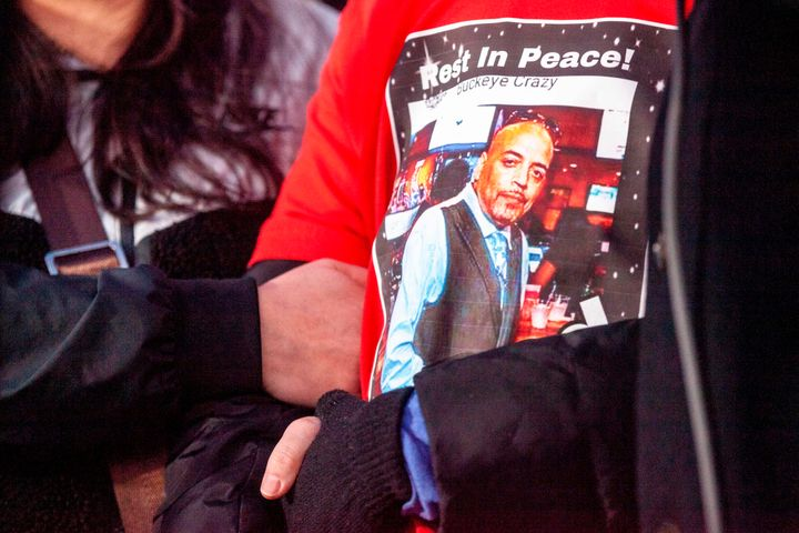 Andre Hill's daughter wears a T-shirt with the image of her father during a press conference and candlelight vigil in Columbu