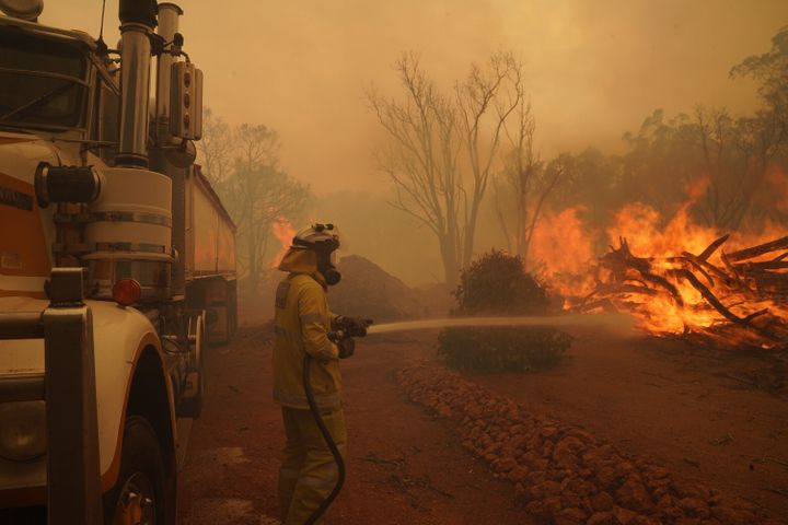 Firefighters attempt to contain a bushfire in Wooroloo on February 2 in Perth.