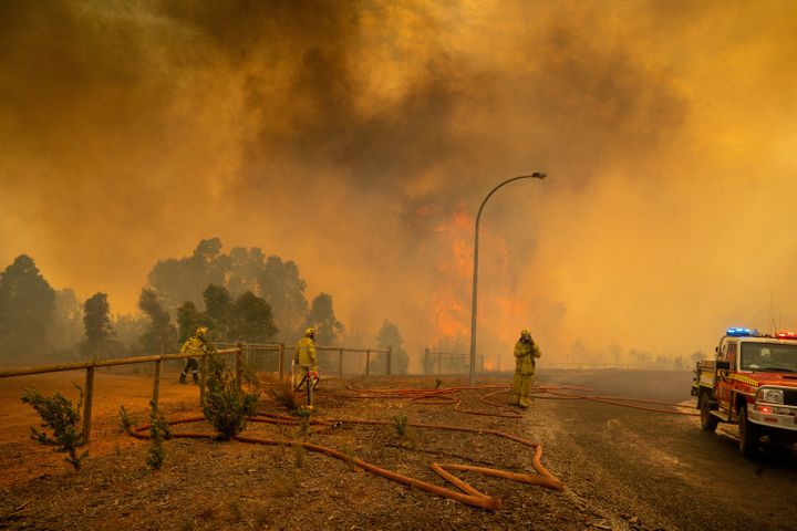 Firefighters set up hoses and equipment in Wooroloo on February 2 in Perth, Australia.