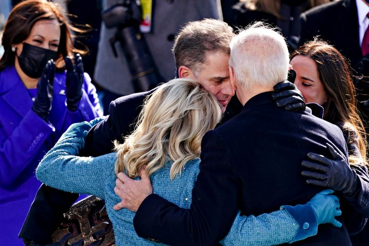 President Joe Biden, right, is comforted by his son Hunter Biden and First Lady Jill Biden after being sworn in during the in