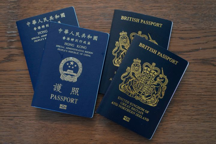British National Overseas (BNO) passports sit on a table on Jan. 31, 2021.China and Hong Kong say they no longer recognize the BNO passport as a valid travel document.