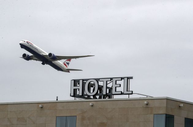 A plane passes over the Sofitel Hotel at Heathrow (file