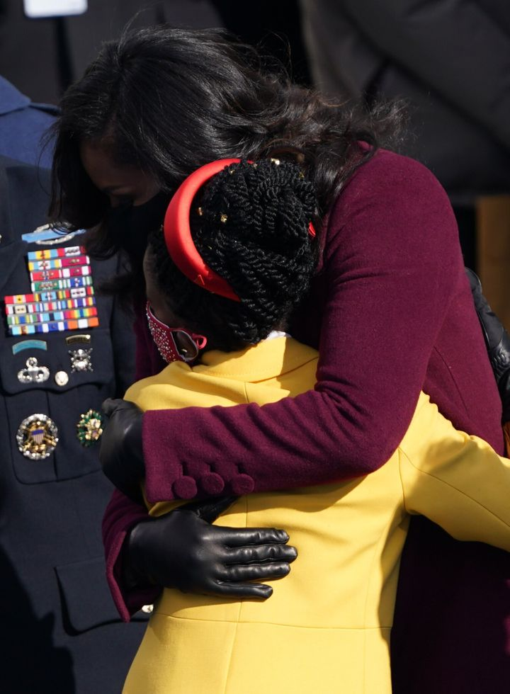 Former first lady Michelle Obama embraces poet Amanda Gorman at the inauguration ceremony on Jan. 20, 2021.