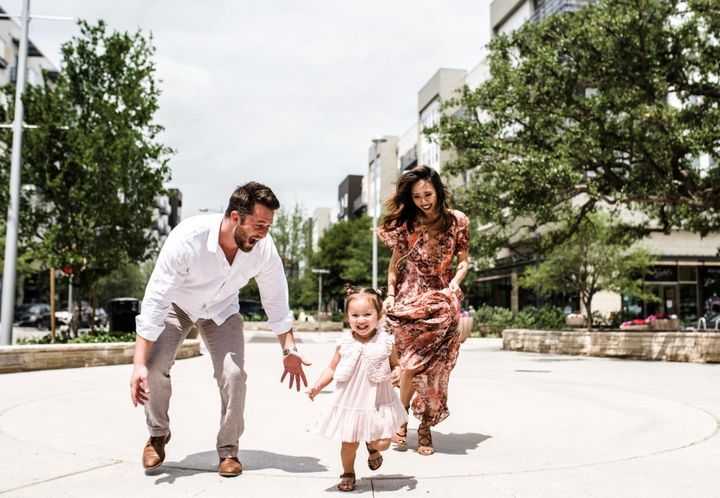 The author with her husband, Ethan, and one of their daughters.