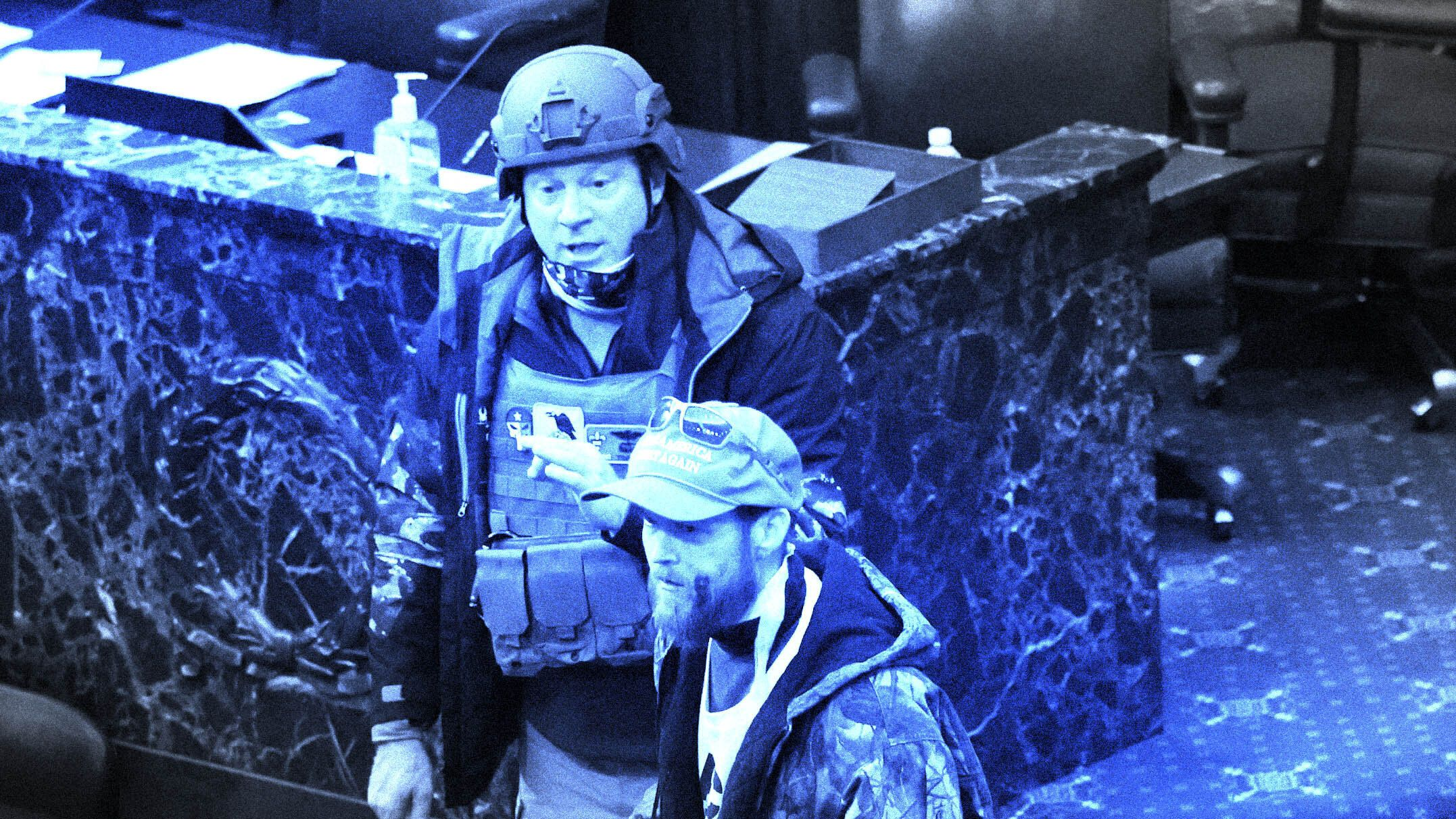 Larry Rendall Brock Jr. wears a combat helmet and vest after entering the Senate chamber on Jan. 6 during the Capitol riot in