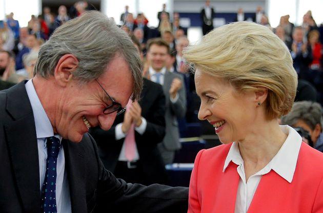 European Commission President Ursula von der Leyen is congratulated by European Parliament President...