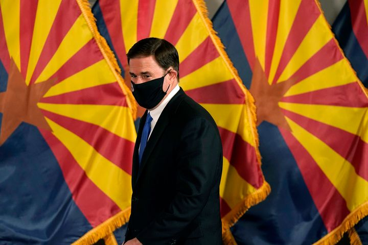 Arizona Gov. Doug Ducey is among the Republicans who is facing challenges from within his own party to emergency executive po