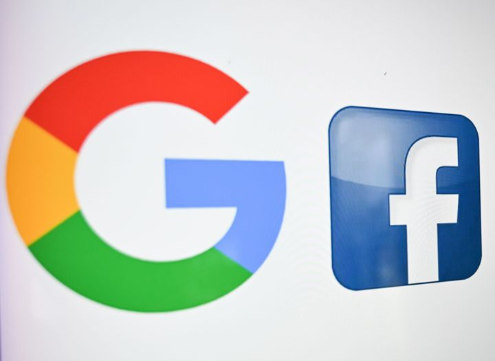 A photo taken on Oct. 21, 2020 shows the logos of Google and Facebook.