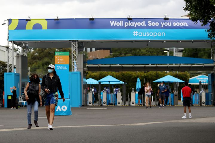 Spectators arrive wearing face masks at Melbourne Park on Friday in Melbourne.