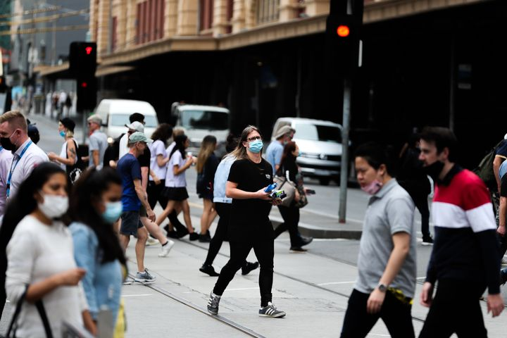 Locals near Melbourne's Flinders Street station on Thursday after Victoria reintroduced COVID-19 restrictions following a quarantine hotel worker testing positive on Wednesday.