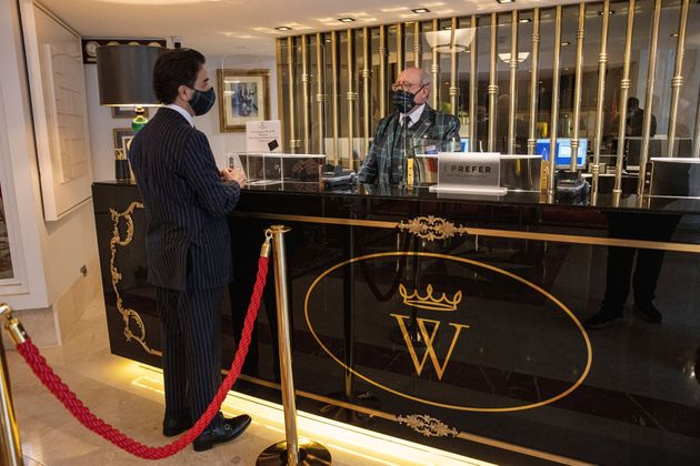 Screens protect staff at the reception desk at the Wellington Hotel in Madrid,