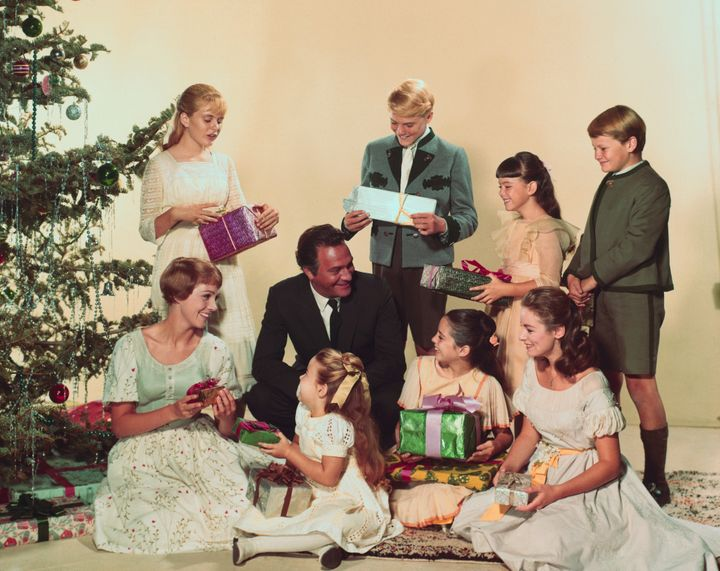 "Julie Andrews (left) and Plummer (center, in suit) in ""The Sound of Music."""