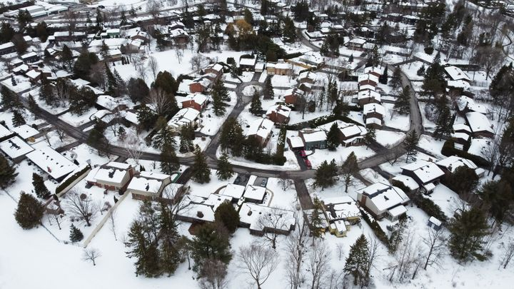 An aerial view of houses in Kanata, a suburb of Ottawa. The region has seen a 12-per-cent jump in the average house price in one month.