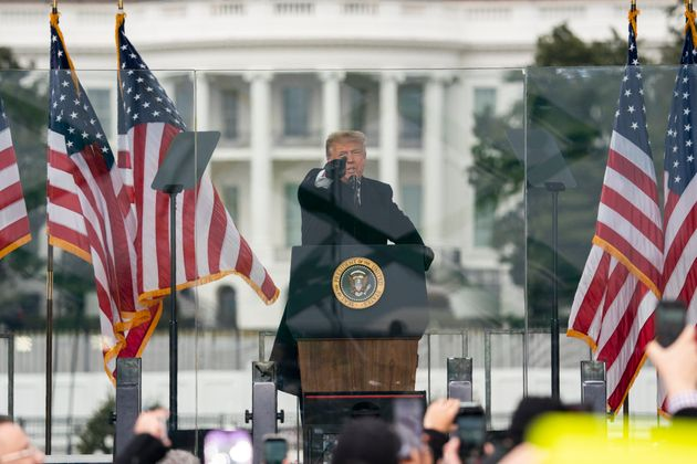 Then-President Donald Trump speaks at a rally protesting the Electoral College certification of Joe Biden...