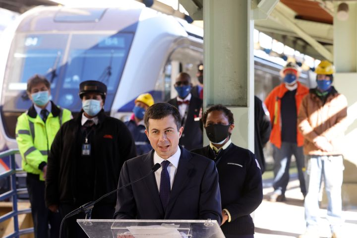 Pete Buttigieg speaks to Amtrak employees during a visit to Union Station in Washington, D.C., on Friday.
