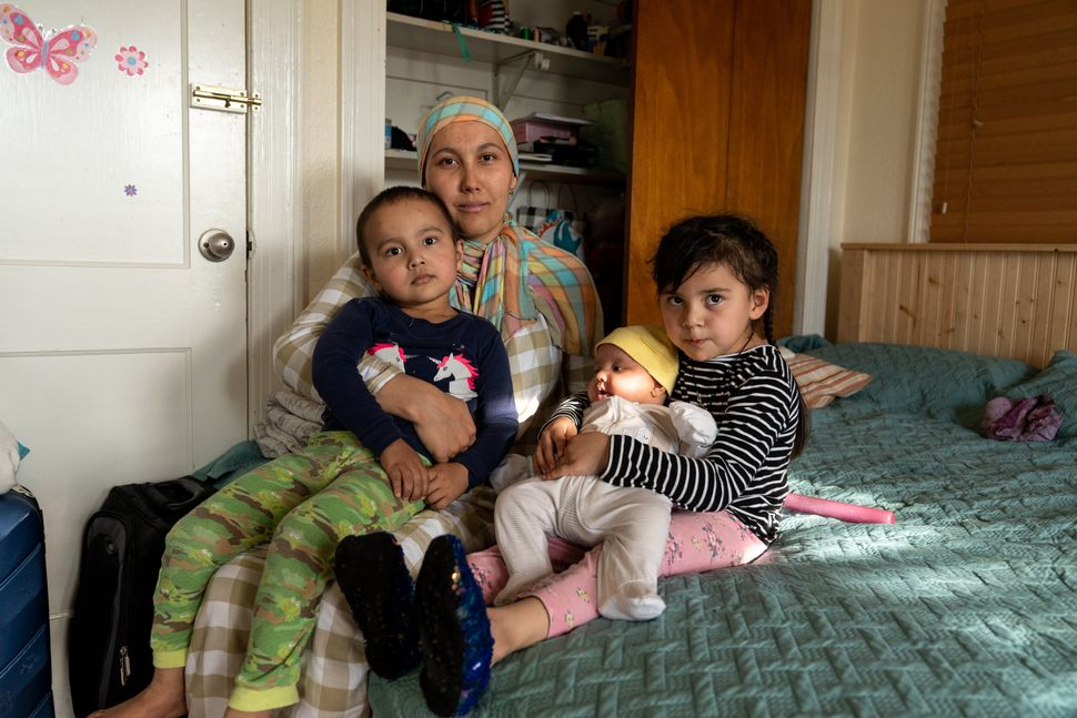 Muhammad's wife, Aida, poses for a portrait with their children on Feb. 4,