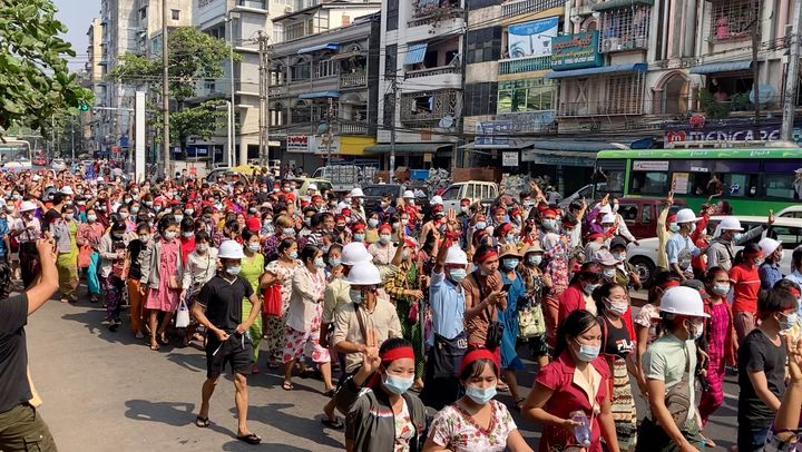 In this image from video, a crowd of protesters march in Yangon, Myanmar Saturday, Feb. 6, 2021.