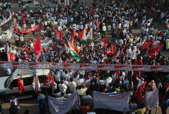 Members of different political parties participate in a protest against new farm laws in Mumbai, India, Saturday, Feb. 6, 202