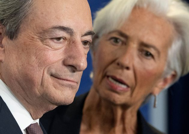 Christine Lagarde, President-designate of the European Central Bank talks to ECB's outgoing President...