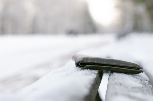 Lost wallet is forgotten by person on a bench in a winter