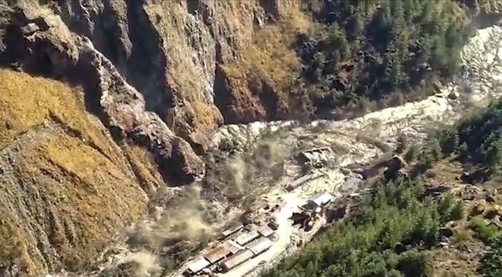 This frame grab from video provided by KK Productions shows a massive flood of water, mud and debris flowing at Chamoli Distr
