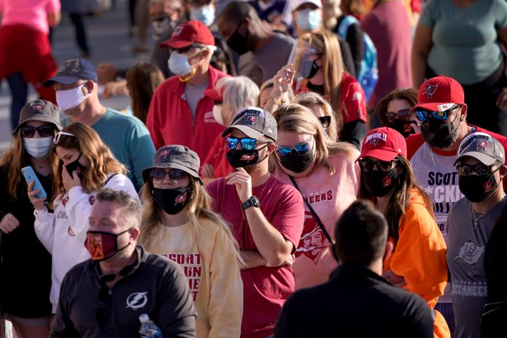 People wait in line for an exhibit at the NFL Experience Thursday, Feb. 4, 2021, in Tampa, Fla. The city is hosting Sunday's