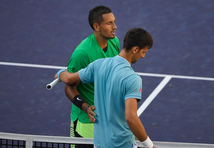 Nick Kyrgios, of Australia, top, shakes hands with Novak Djokovic, of Serbia, after Kyrgios beat Djokovic at the BNP Paribas Open tennis tournament, Wednesday, March 15, 2017, in Indian Wells, Calif.