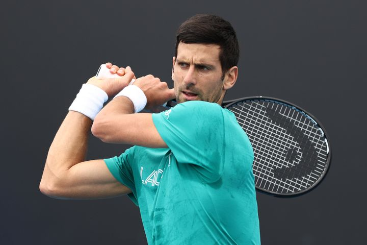 Novak Djokovic of Serbia plays a backhand during a practice session ahead of the 2021 Australian Open at Melbourne Park on February 07, 2021 in Melbourne, Australia.