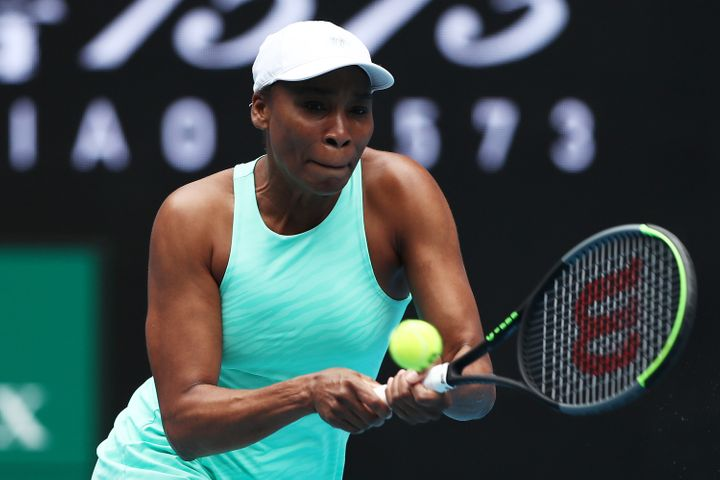 Venus Williams of The United States of America plays a backhand in her Women's Singles first round match against Kirsten Flipkens of Belgium during day one of the 2021 Australian Open at Melbourne Park on February 08, 2021.