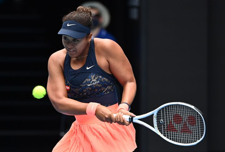Naomi Osaka of Japan plays a backhand in her Women's Singles first round match against Anastasia Pavlyuchenkova of Russia during day one of the 2021 Australian Open at Melbourne Park on February 08, 2021.