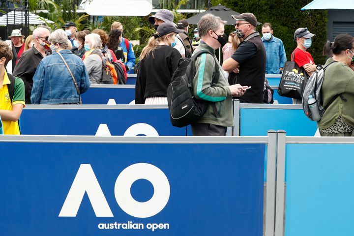 Spectators wear face masks as they arrive on day one of the 2021 Australian Open at Melbourne Park on February 08, 2021 in Melbourne, Australia.