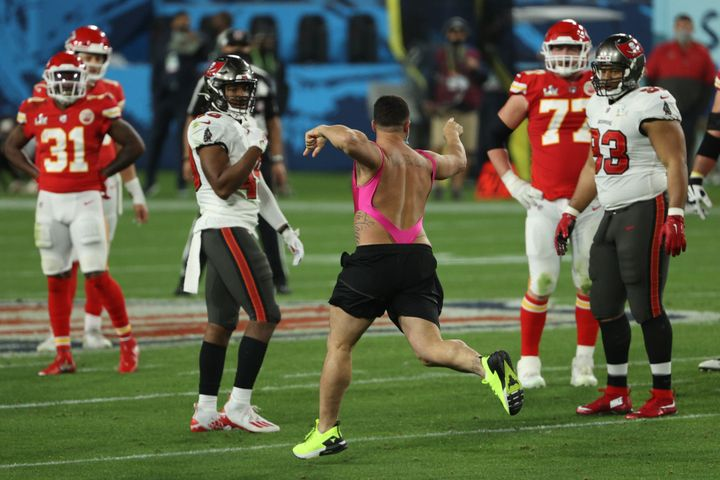 An unidentified man takes the field during the fourth quarter in the 2021 Super Bowl between the Tampa Bay Buccaneers and the