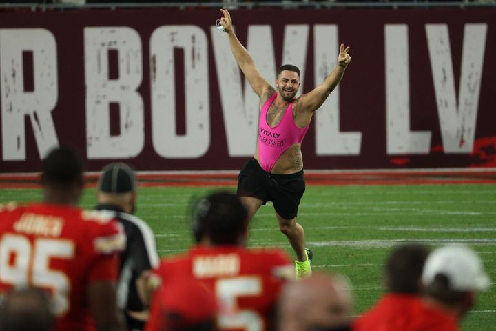 A man in a hot pink body thong caused a brief play suspension in the fourth quarter.