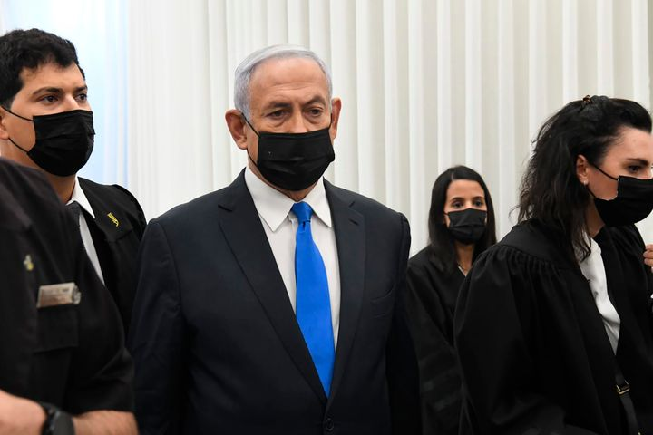 Israeli Prime Minister Benjamin Netanyahu stands at a hearing at the district court in Jerusalem, on Feb. 8, 2021.