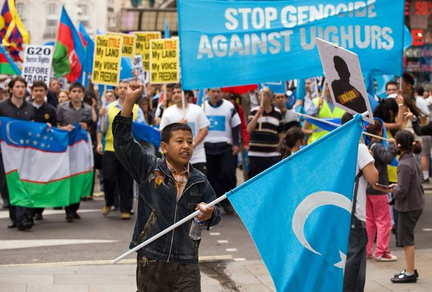 UK Uighurs and their supporters demonstrate through central London in