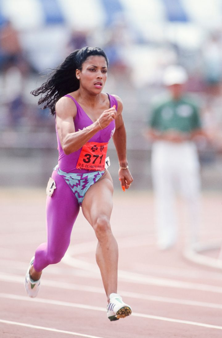 Florence Griffith Joyner running in one of her bold one-legged uniforms at the 1988 U.S. Olympic track and field trials.