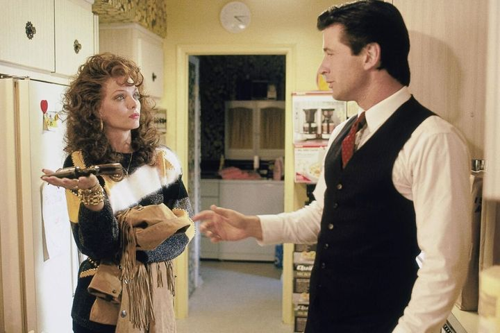"Pfeiffer and Alec Baldwin in ""Married to the Mob."""