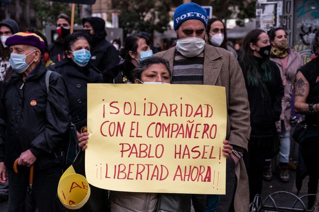 MADRID, SPAIN - 2021/02/06: A protester holds a placard with the words 'solidarity with comrade Pablo...