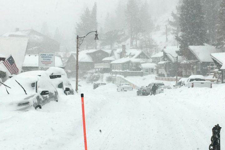 Heavy snowfall blankets cars at June Lake in Mono County, California, on Jan. 27.