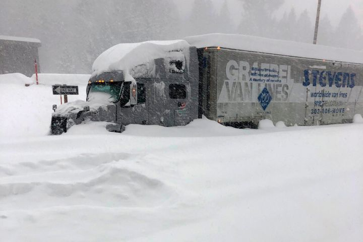 A tractor-trailer is stuck in heavy snowfall near Mono County, California, on Jan. 27. An atmospheric river storm pumped dren