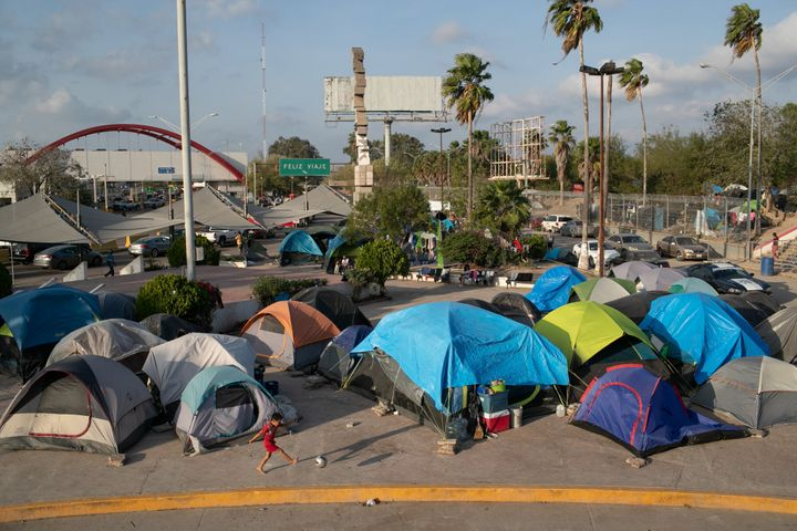 A camp for asylum-seekers stands next to the international bridge to the United States in Matamoros, Mexico.