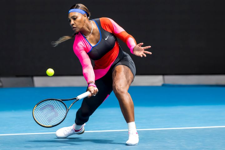 Serena Williams returns the ball during round 1 of the 2021 Australian Open.