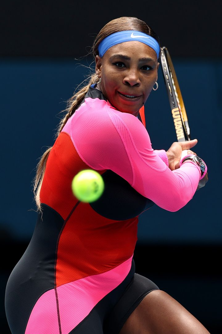 Serena Williams plays a backhand in her Women's Singles first round match against Laura Siegemund of Germany.